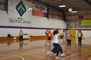 girls playing indoor netball