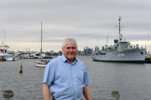 Peter Hemphill in front of boats in Williamstown